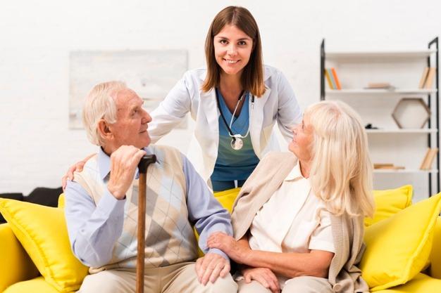 nurse taking care old man woman